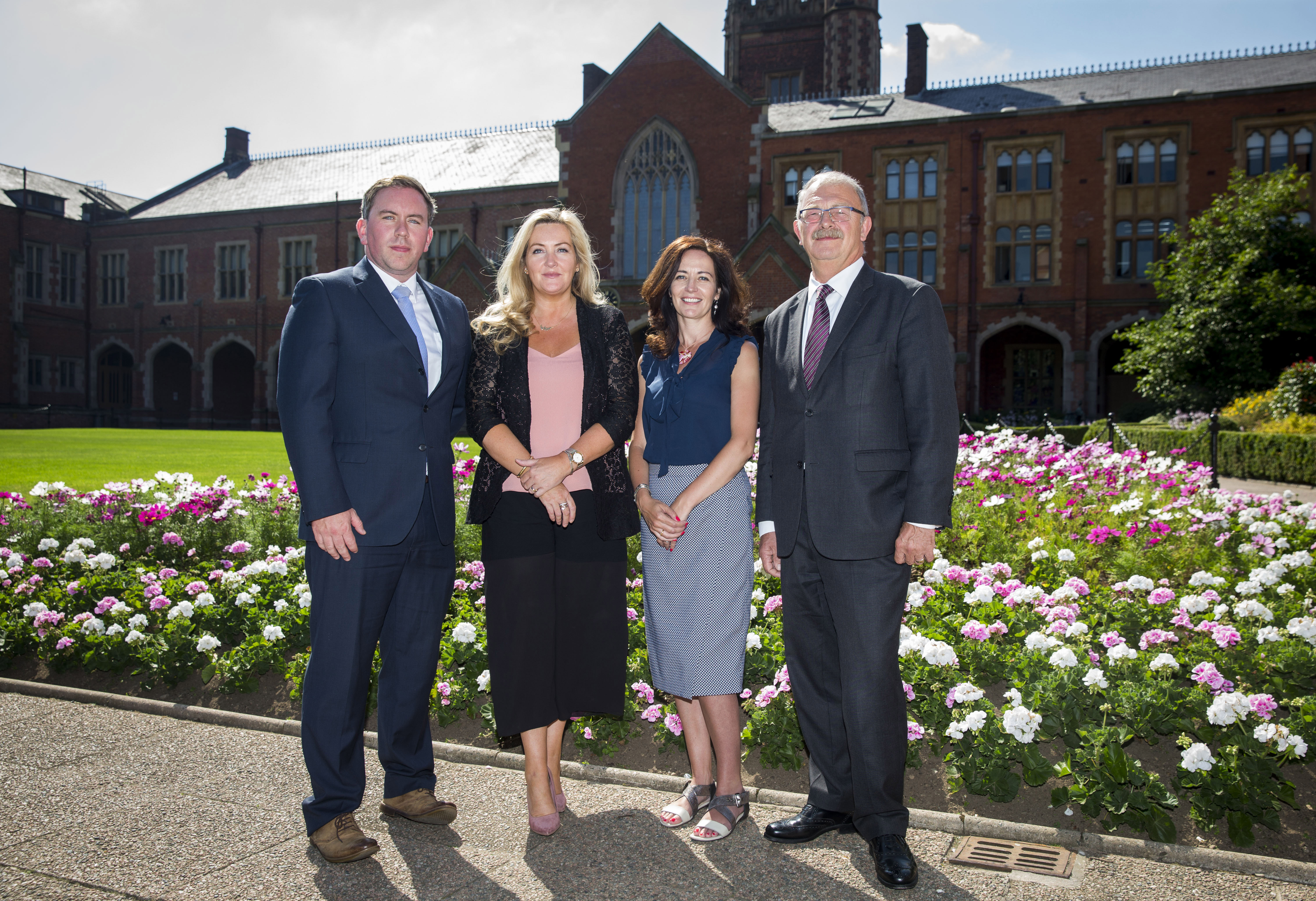 Photo of CEO of SEUPB and project partners at QUB campus
